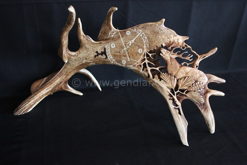 Carving into antlers theme deer